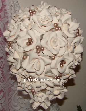 "Cascade Bouquet of Medium ""D"" Regular and Reality Roses in assorted sizes"