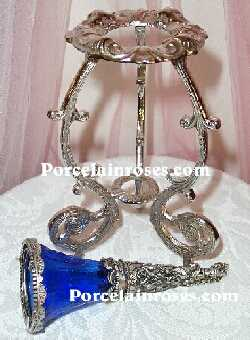 blue glass with rose bouquet holder